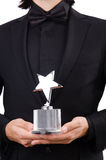 Businessman with star award isolated. On white Stock Photo