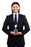 Businessman with star award isolated. On white Royalty Free Stock Photos