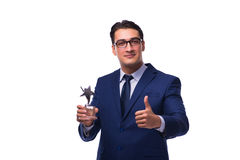 The businessman with star award isolated on white. Businessman with star award isolated on white Stock Photography
