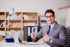 The businessman with star award in office Royalty Free Stock Photos