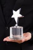Businessman with star award  Stock Photos