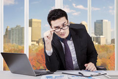 Businessman staring at the camera in office Royalty Free Stock Image