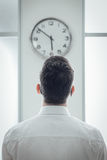 Businessman staring at the clock Royalty Free Stock Photography