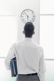 Businessman staring at the clock Royalty Free Stock Photo