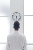 Businessman staring at the clock Stock Image