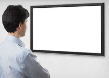 Businessman staring at tv with blank screen. For copy space. Rear view. Isolated on white Royalty Free Stock Image