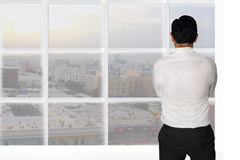 Businessman Starring Window. Vision concept image rear view of a businessman starring outside window looking at opportunities Stock Photos