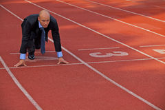Businessman at the start line of running track Royalty Free Stock Photos