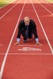 Businessman at the start line of running track Stock Images