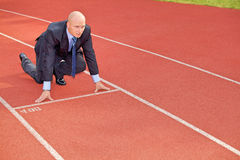 Businessman at the start line of running track Royalty Free Stock Images