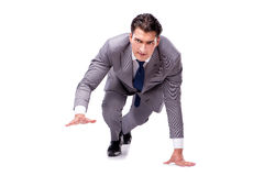 The businessman on start ready for running isolated on white. Businessman on start ready for running isolated on white Royalty Free Stock Photography