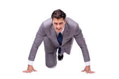 The businessman on start ready for running isolated on white. Businessman on start ready for running isolated on white Royalty Free Stock Images