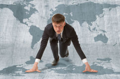 Businessman start WTO. Young businessman standing in start pose ready to run.  WTO concept Stock Photo