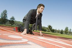 Businessman At The Starting Blocks Royalty Free Stock Image