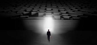 Businessman starting a dark labyrinth challenge royalty free illustration