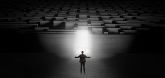 Businessman starting a dark labyrinth challenge stock images