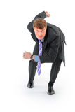 Businessman on starting line. Isolated over white background Royalty Free Stock Photography