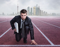 Businessman on starting position. Before cityscape Stock Images