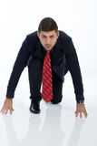 Businessman in a starting position, isolated on a white. Young businessman in a starting position stock images