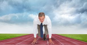 Businessman at starting position on tracks against storm clouds Royalty Free Stock Photos