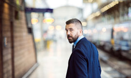 Businessman at the station Stock Photography