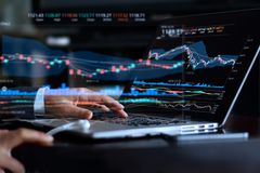 Businessman with statistic graph of stock market financial. Indices analysis on laptop screen, finance data and technology concept stock image
