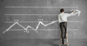 Businessman and statistics trend Stock Photo