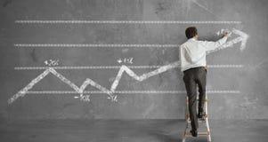 Businessman and statistics trend Stock Photo