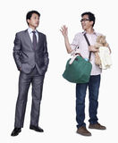 Businessman and stay in home father, studio shot Stock Images