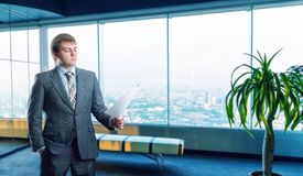 Businessman staying infront of city view Royalty Free Stock Photography