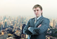 Businessman staying infront of city view Royalty Free Stock Photos