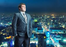 Businessman staying infront of city view Royalty Free Stock Images
