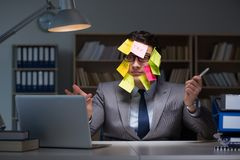 The businessman staying late to sort out priorities Stock Photo