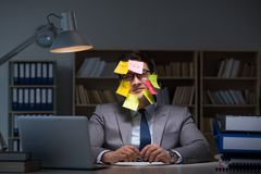 The businessman staying late to sort out priorities. Businessman staying late to sort out priorities stock photo