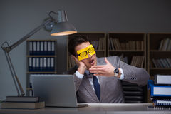 The businessman staying late to sort out priorities Stock Photos