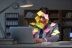 The businessman staying late to sort out priorities Stock Image