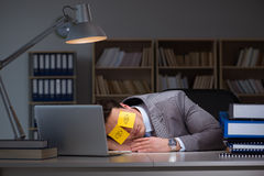 The businessman staying late to sort out priorities. Businessman staying late to sort out priorities royalty free stock photo