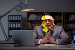 The businessman staying late to sort out priorities Stock Images