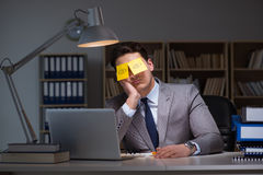 The businessman staying late to sort out priorities. Businessman staying late to sort out priorities stock image