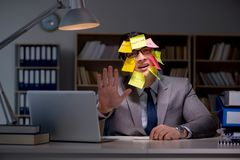 The businessman staying late to sort out priorities. Businessman staying late to sort out priorities stock photos