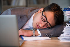The businessman staying in the office for long hours Royalty Free Stock Photography