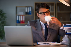 The businessman staying in the office for long hours. Businessman staying in the office for long hours royalty free stock photo