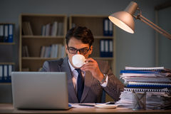 The businessman staying in the office for long hours. Businessman staying in the office for long hours Royalty Free Stock Photography