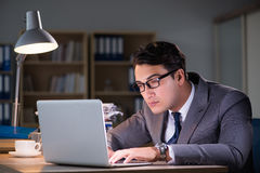 The businessman staying in the office for long hours Royalty Free Stock Photos