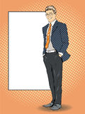 Businessman stays next to blank white board. Pop art comics retro style vector illustration. Put your own text.  Stock Photography