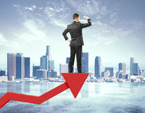 Businessman stays on red arrow from business graph and looking i Stock Photos