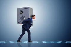 The businessman stealing metal safe from bank Stock Photography