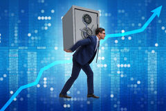The businessman stealing metal safe from bank Royalty Free Stock Photography