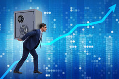 The businessman stealing metal safe from bank Royalty Free Stock Image