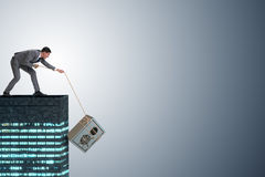 The businessman stealing safe from building Stock Image